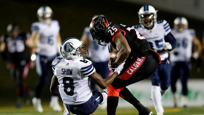 Calgary Stampeders Campbell intercepts a pass intended for Toronto Argonauts Shaw during their CFL football game in Calgary.