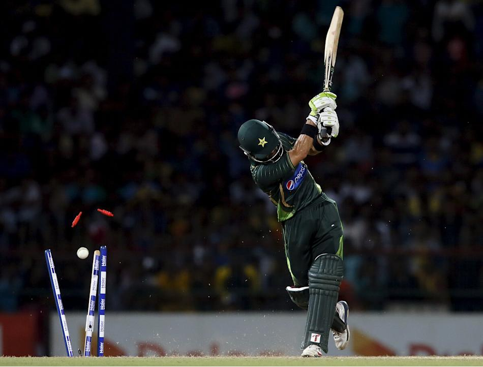 Pakistan's Rizwan is bowled out by Sri Lanka's Perera during their second Twenty 20 cricket match in Colombo