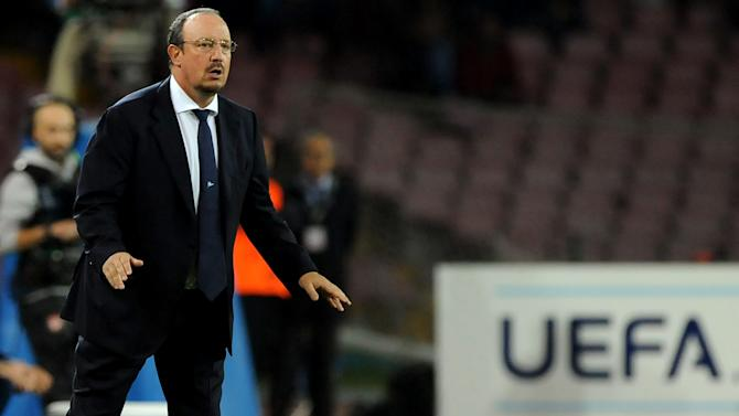 Napoli coach Rafa Benitez gives indications to his players during a Champions League, group F, soccer match between Napoli and Marseille, at the Naples San Paolo stadium, Italy, Wednesday, Nov. 6, 2013