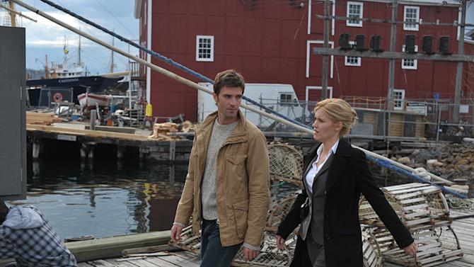 """Emily Rose as Audrey Parker and Lucas Bryant as Nathan Wuomos in """"Haven."""""""