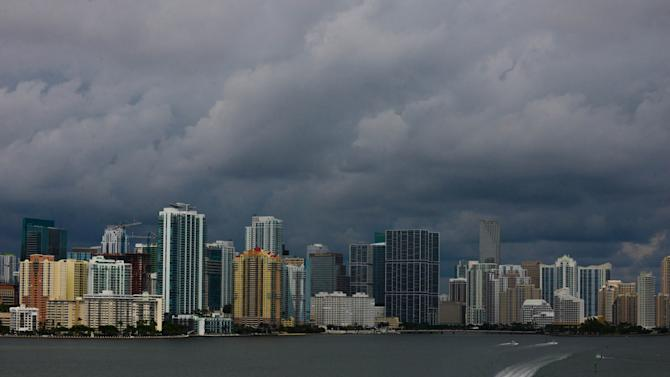 Downtown Miami is engulfed in storm clouds as Tropical Storm Karen heads toward Florida's Panhandle on Thurdsay, Oct. 3, 2013. The storm threatened to become the first named tropical system to menace the United States this year. (AP Photo/The Miami Herald, Shannon Kaestle) MAGS OUT