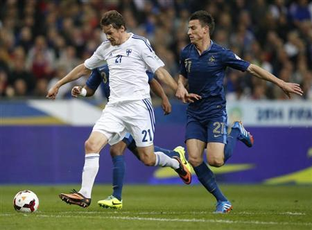 Finland's Hamalainen challenges France's Koscielny during their 2014 World Cup qualifying soccer match at the Stade de France stadium in Saint-Denis