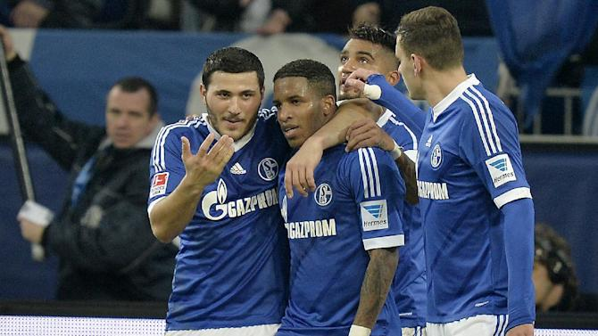 Schalke's Jefferson Farfan, 2nd from left,  is celebrated by teammates after scoring a penalty during the German Bundesliga soccer match between FC Schalke 04 and SC Freiburg in Gelsenkirchen, Germany, Sunday, Dec. 15, 2013