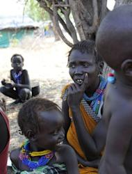 A handout picture released by the UN on January 5, shows internally displaced persons resting in Pibor, Jonglei state after fleeing the surrounding areas following a wave of bloody ethnic violence. Over 3,000 people were killed in South Sudan in brutal massacres last week in an explosion of ethnic violence, a local official said Friday as the UN increased patrols