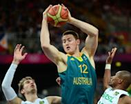 Australian centre Aron Baynes (centre) lines up a shot as Australia takes on Brazil during the men's London 2012 Olympics basketball tournament on July 29. The Australian side, lacking NBA star centre Andrew Bogut, came up short in its Olympic opener, falling to a Brazil team with four NBA standouts 75-71 on Sunday in round-robin Group B play
