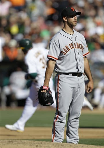 Belt drives in three runs, leads Giants past A's
