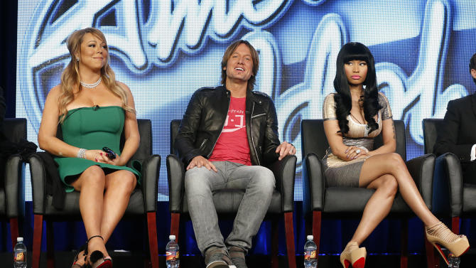 "In this Jan. 8, 2013 photo, from left, Mariah Carey, Keith Urban and Nicki Minaj from ""American Idol"" attend the Fox Winter TCA Tour at the Langham Huntington Hotel, in Pasadena, Calif. ""American Idol"" returns Wednesday, Jan. 16, 2013, for season 12. All is not well in the once peaceful land of ""American Idol,"" despite a shake-up at the beginning of this season that was supposed to rejuvenate the aging Fox talent competition. Instead, the behind-the-scenes-and-sometimes-in-front-of-the-scenes drama continues to cast a shadow over the series, right up to the Thursday, May 16, 2013, coronation of its 12th season champion. (Photo by Todd Williamson/Invision/AP, File)"