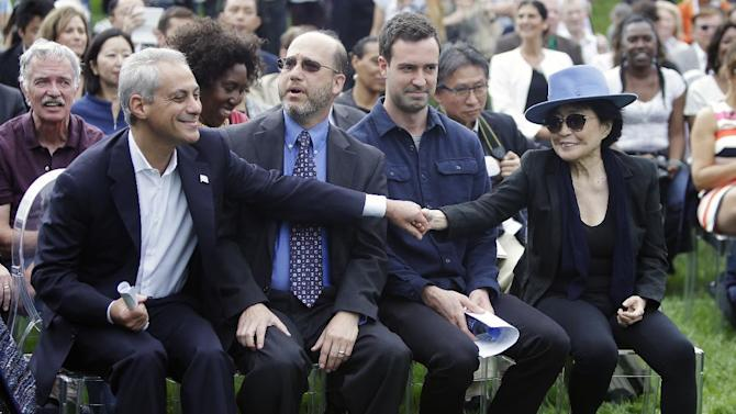 Chicago Mayor Rahm Emanuel, left, reaches over to shake hands with Yoko Ono before the dedication ceremony for the permanent art installation of SKYLANDING, at Jackson Park, Monday, Oct. 17, 2016, in Chicago. SKYLANDING is Ono's first permanent public art installation in the United States. (AP Photo/Kiichiro Sato)