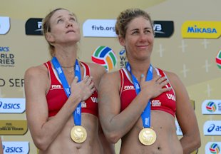 LONG BEACH, CA - JULY 27: Kerri Walsh Jennings of the United States (L) with April Ross on the podium after earning the Gold Medal during the FIVB Long Beach Grand Slam on July 27, 2014 in Long Beach, California. (Photo by Robert Laberge/Getty Images)