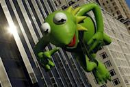 The Kermit the Frog balloon floats during the 86th Macy's Thanksgiving day parade in New York November 22, 2012. REUTERS/Brendan McDermid/Files