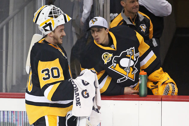 Pittsburgh Penguins goalie Matt Murray (30) takes a timeout and visits with goalie Marc-Andre Fleury (29) during the first period of an NHL hockey game against the Carolina Hurricanes in Pittsburgh, Thursday, March 17, 2016. The Penguins won 4-2. (AP Photo/Gene J. Puskar)