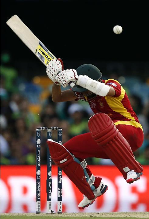 Zimbabwe's Sikandar Raza avoids a short delivery from Pakistan's Mohammad Irfan during their Cricket World Cup match at the GABBA in Brisbane