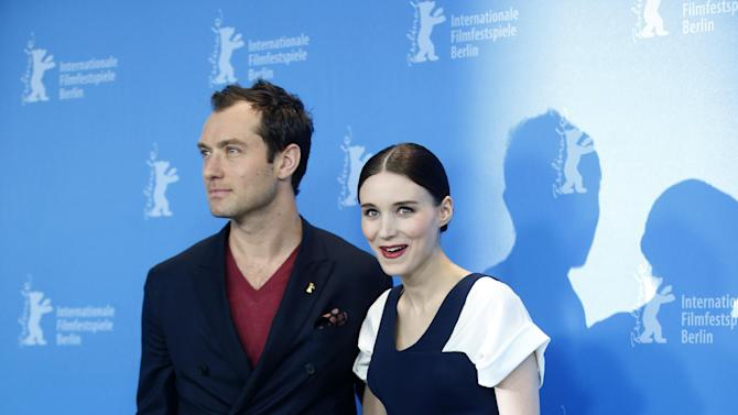 Actors Jude Law and Rooney Mara pose for photographers at the photo call for the film Side Effects at the 63rd edition of the Berlinale, International Film Festival in Berlin, Tuesday, Feb. 12, 2013. (AP Photo/Michael Sohn)