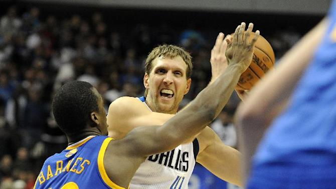 Dallas Mavericks power forward Dirk Nowitzki (41) drives to the basket against Golden State Warriors small forward Harrison Barnes (40) in the second half during an NBA basketball game on Wednesday, Nov. 27, 2013 in Dallas. The Mavericks won 103-99
