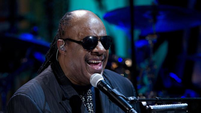 "FILE - In this Wednesday, May 9, 2012 file photo, Stevie Wonder performs during the ""In Performance at the White House"" in the East Room of the White House in Washington, honoring songwriters Burt Bacharach and Hal David, recipients of the 2012 Library of Congress Gershwin Prize for Popular Song. Two people charged with extorting the Grammy-winning musician pleaded no contest to the charges on Monday Sept. 24, 2012, and have been sentenced to serve 292 days in jail. (AP Photo/Carolyn Kaster, File)"