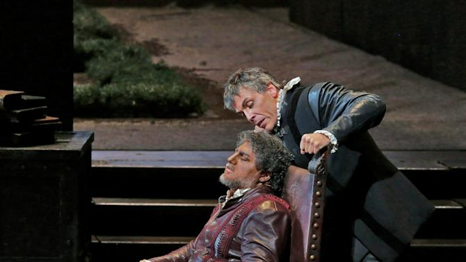 "In this March 11, 2013 photo provided by the Metropolitan Opera, Thomas Hampson, right, plays Iago with Jose Cura, seated, in the title role during a performance of of Verdi's ""Otello,"" at the Metropolitan Opera in New York. (AP Photo/Ken Howard)"