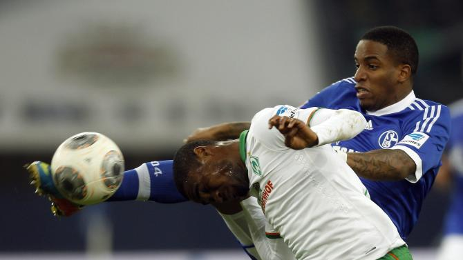 Schalke 04's Farfan tackles Werder Bremen's Makiadi during the German first division Bundesliga soccer match in Gelsenkirchen