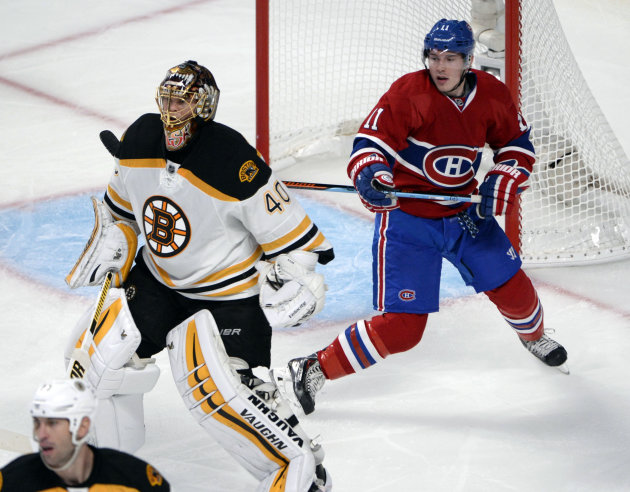 Oct 16, 2014; Montreal, Quebec, CAN; Montreal Canadiens forward Brendan Gallagher (11) behind Boston Bruins goaltender Tuukka Rask (40) during the second period at the Bell Centre. (Eric Bolte-USA TODAY Sports)