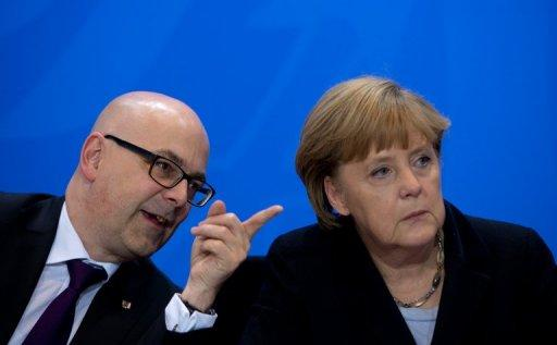 (L-R) Thorsten Albig, Schleswig Holstein's State Premier and German Chancellor Angela Merkel address a press conference at the Chancellery in Berlin. The country moved closer to a fresh bid to ban neo-Nazi party NPD.
