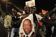 Opposition challenger Macky Sall supporters celebrate their candidate victory at their campaign headquarters in Dakar. Sall on Monday hailed a new era after triumphing over veteran leader Abdoulaye Wade in a presidential poll lauded the world over as an example for African democracy