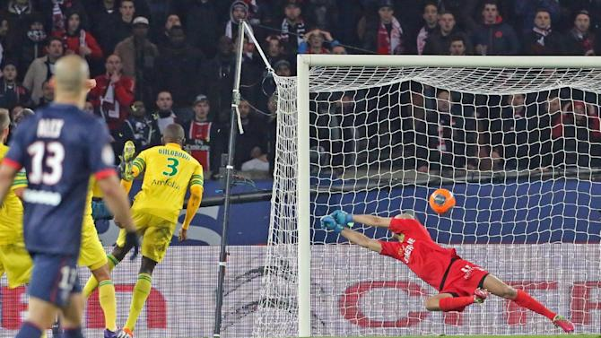 Paris Saint Germain's Zlatan Ibrahimovic of Sweden, hidden at left, scores the fifth goal for Paris, as Nantes goalkeeper Remy Riou prepares to jump, during the League One soccer match between Paris Saint Germain and Nantes at the Parc des Princes stadium in Paris, Sunday Jan. 19, 2014