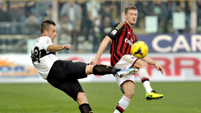 AC Milan's Abate fights for the ball with Parma's Cassano during their Italian Serie A soccer match at the Tardini stadium in Parma