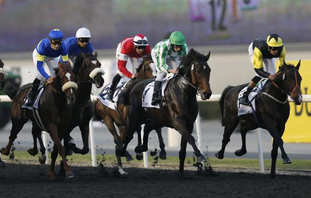 "Moore, riding Lines of Battle of the U.S., races towards the finish line during the fourth race ""UAE Derby"" of the Dubai World Cup at the Meydan Racecourse in Dubai"