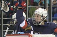 Hilary Knight (right) congratulates Kelli Stack (left), as Stack scores for the US against Finland during the Women's Ice Hockey Group A match at the Shayba Arena during the Sochi Winter Olympics on February 8, 2014