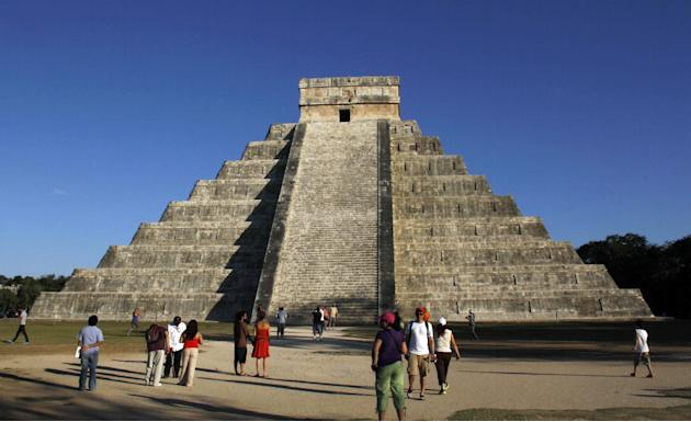 People gather in front of the Kukulkan Pyramid in Chichen Itza, Mexico, Thursday, Dec. 20, 2012. American seer Star Johnsen-Moser led a whooping, dancing, drum-beating ceremony Thursday in the heart o