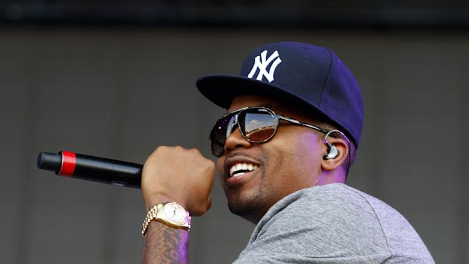 """FILE - In this June 15, 2013 file photo, Nasir bin Olu Dara Jones, better known as Nas, performs at the 2013 Bonnaroo Music and Arts Festival in Manchester, Tenn. Harvard University announced Tuesday, July 16, that the 39-year-old rapper is being honored with the Nasir Jones Hip-Hop Fellowship at its W. E. B. Du Bois Institute. It is a joint venture with Harvard's Hip-Hop Archive. The fellowship will assist students who excel in the arts """"in connection with hip-hop."""" Nas is one of hip-hop's most celebrated lyricists, best known for his reflective rhymes and deep storytelling. (Photo by Wade Payne/Invision/AP, File)"""
