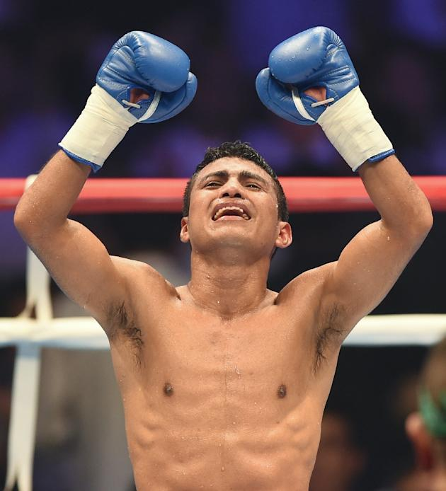 World Boxing Council new flyweight champion Roman Gonzalez of Nicaragua celebrates his victory over Akira Yaegashi of Japan during their title bout in Tokyo on September 5, 2014