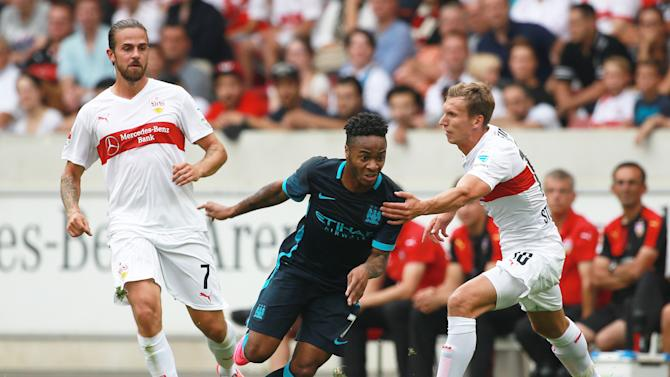 VfB Stuttgart's Florian Klein in action with Manchester City's Raheem Sterling