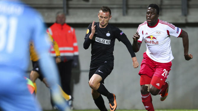 RB Salzburg's Rodnei, right, and Esbjerg fB's Jakob Ankersen run for the ball during their Europa League group C soccer match, Thursday, Oct. 3, 2013 in Esbjerg, Denmark