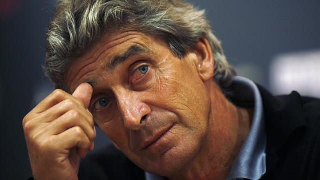 Champions League - Malaga coach Pellegrini back for Dortmund quarter-final