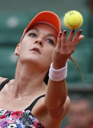 Radwanska of Poland serves to Zhang of China during their women's singles match at the French Open tennis tournament at the Roland Garros stadium in Paris