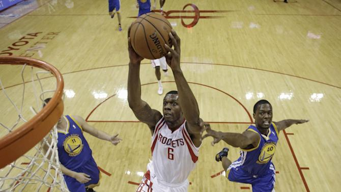 Houston Rockets' Terrence Jones (6) goes up for a shot as Golden State Warriors' Harrison Barnes (40) defends during the first quarter of an NBA basketball game Friday, Dec. 6, 2013, in Houston