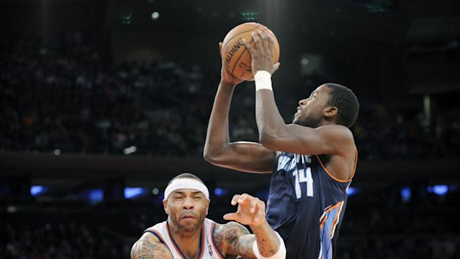 Charlotte Bobcats' Michael Kidd-Gilchrist (14) is fouled by New York Knicks' Kenyon Martin during the fourth quarter of an NBA basketball game Tuesday, Nov. 5, 2013, at Madison Square Garden in New York. The Bobcats defeated the Knicks 102-97