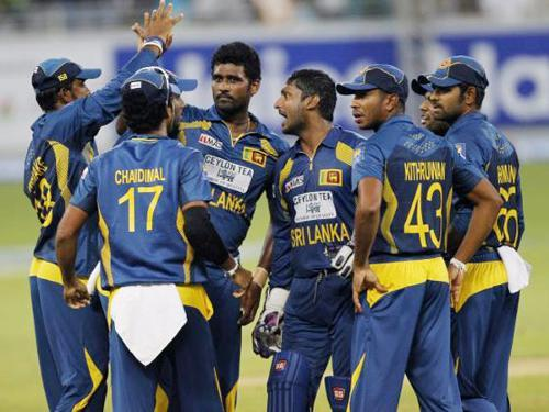 Sri Lanka's Thisara Perera (C) celebrates with his team mates the wicket of Pakistan's Sohaib Maqsood during their second Twenty20 international cricket match in Dubai on Friday. — Reuters