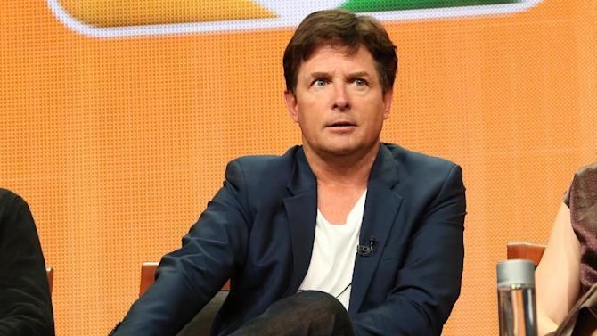 """This publicity image released by NBC shows actor Michael J. Fox from the """"The Michael J. Fox Show"""" panel during the NBCUniversal Press Tour in Beverly Hills, Calif., on Saturday, July 27, 2013. Fox will star as Mike Henry, a former local NBC newscaster with Parkinson's. (AP Photo/NBC, Chris Haston)"""