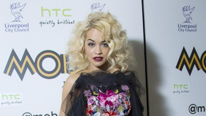 """FILE - In this Nov. 3, 2012 file photo, singer Rita Ora arrives in the press room  after winning the award for 'Best Newcomer' at the 2012 MOBO Awards at the Echo Arena in Liverpool. """"MTV's Club NYE 2013"""" will feature performances from Ke$ha, Ne-Yo, Sean Kingston, Rita Ora and others.  (Photo by Joel Ryan/Invision/AP, File)"""