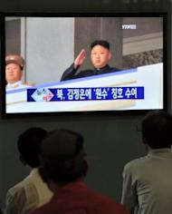"""South Korean menwatch a TV report about the title of 'Marshal' awarded to North Korea's leader Kim Jong-Un on July 19. North Korea's threat of a nuclear review came after the North arrested a man who was allegedly trying to blow up a monument to Kim Il-Sung, an act which the foreign ministry described as a """"war action as serious as the armed invasion"""""""