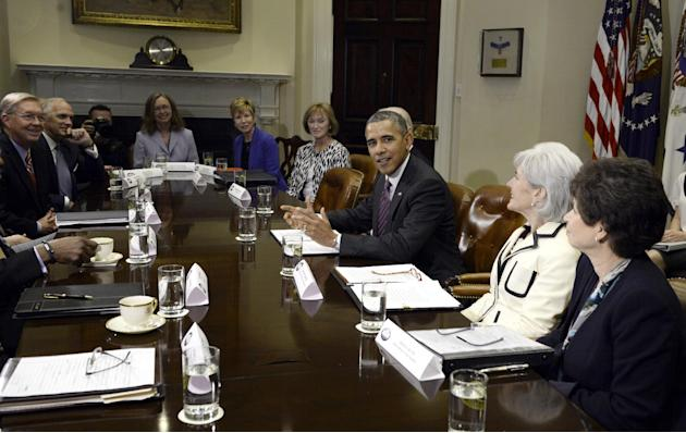 President Barack Obama meets with insurance company executives, Thursday, April 17, 2014, in the Roosevelt Room of the White House in Washington. From right to left are, White House Senior Adviser Val