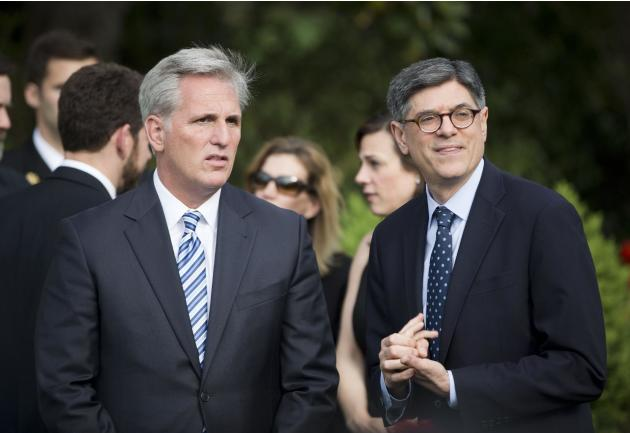 House Majority Leader Kevin McCarthy of Calif., left, talks with Treasury Secretary Jacob Lew, right, in the Rose Garden of the White House in Washington, at they wait to hear President Barack Obama s