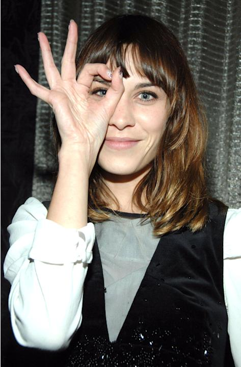 Celebrity photos: Alexa Chung struck a cute pose at the Jesse Frohman Kurt Cobain photography exhibition in New York this week. Girl crush alert.