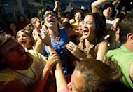 Supporters of Miranda State governor Henrique Capriles Radonski celebrate his victory on December 16, 2012.