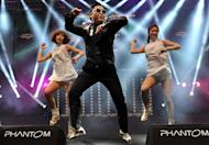 """Psy (L) performs his hit single """"Gangnam Style"""" during a concert in Istanbul on February 22, 2013. The South Korean singer is promising a """"Psy style"""" take on a traditional Korean dance to accompany the release next week of the highly-anticipated follow-up to """"Gangnam Style"""""""