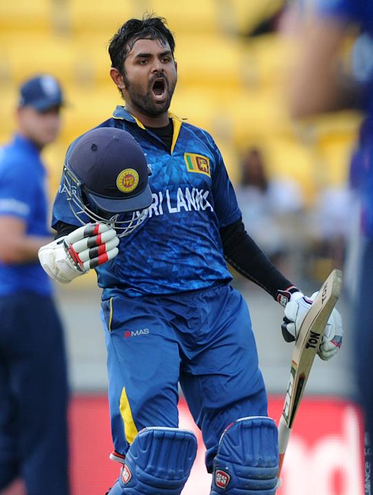 Sri Lanka's Lahiru Thirimanne celebrates after scoring a century against England during their Cricket World Cup match in Wellington, New Zealand, Sunday, March 1, 2015. (AP Photo Ross Setford)
