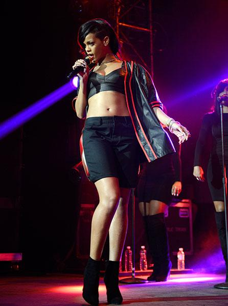"Day 1: Rihanna on stage in Mexico City - Mel Ottenberg, Rihanna's tour stylist, told Vogue.com that this ""Hood Glamour"" look consisted of ""boys' thug clothes mixed with diamonds and pulled-together ha"