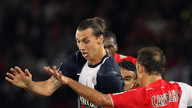 Paris Saint Germain's forward Zlatan Ibrahimovic from Sweden, left, challenges for the ball with Monaco's defender Ricardo Carvalho from Portugal, during their French League One soccer match, at the Parc des Princes stadium, in Paris, Sunday, Sept. 22, 2013