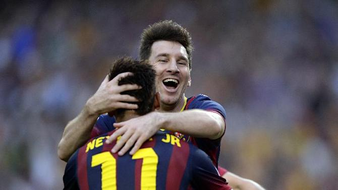 FC Barcelona's Neymar, from Brazil, celebrates scoring against Real Madrid with teammate Lionel Messi from Argentina, facing, during a Spanish La Liga soccer match at the Camp Nou stadium in Barcelona, Spain, Saturday, Oct. 26, 2013